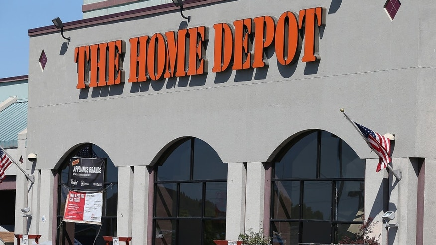 EL CERRITO, CA - MAY 21:  A truck drives in front of a Home Depot store on May 21, 2013 in El Cerrito, California.  Home Depot reported an 18 percent surge in first quarter income with earnings of $1.23 billion, or 83 cents a share compared to $1.04 billion, or 68 cents a share one year ago.  (Photo by Justin Sullivan/Getty Images)