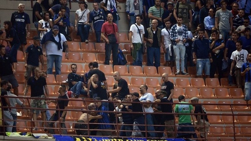 Fans fight in the stands at San Siro during the match between Inter Milan and Juventus on Saturday. Inter, the last Italian side to win the Champions League, in 2010 when they won the treble under Jose Mourinho, are reported to be desperate for a move away from the San Siro ground they share with city rivals AC Milan.