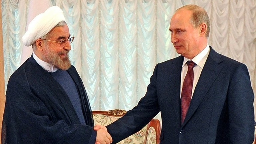 Hassan Rowhani (left) meets Russian President Vladimir Putin in Bishkek, Kyrgyzstan, last week. A moderate by Iran's political standards, the mid-ranking cleric won a surprise victory in the Islamic republic's June presidential election.