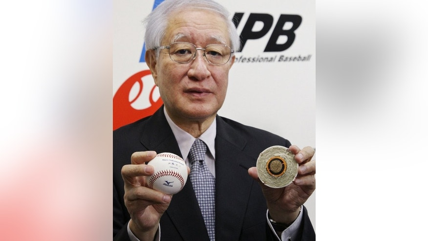 In Tokyo on August 23, 2012 Ryozo Kato shows the official ball for Japan's professional baseball games. Kato had been under pressure since the scandal erupted in June, but the 72-year-old steadfastly refused to step down until now.