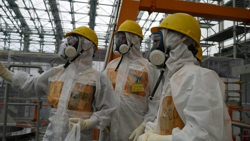 Workers inspect the Fukushima Dai-ichi nuclear power plant on September 12, 2013, in a photo taken by Tokyo Electric Power Co (TEPCO). Japanese Prime Minister Shinzo Abe Thursday ordered the operator of the crippled Fukushima nuclear plant to work out a schedule for stemming radioactive water leaks as he toured the facility.