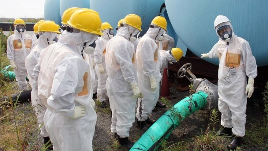 Sept. 13, 2013: In this photo, members of a prefectural committee on the Fukushima Dai-ichi nuclear plant inspect tanks holding toxic water at the tsunami-crippled plant in Okuma town, Fukushima prefecture, northeastern Japan.