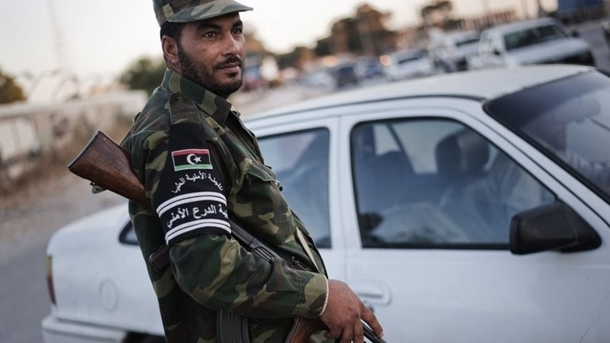 A Libyan member of the High Security Commitee for Tripoli mans a checkpoint on May 25, 2012. Ousted Libyan dictator Moamer Kadhafi's son appeared in court Thursday in Zintan where he is being held by ex-rebels on the same day he was due in Tripoli on security charges.