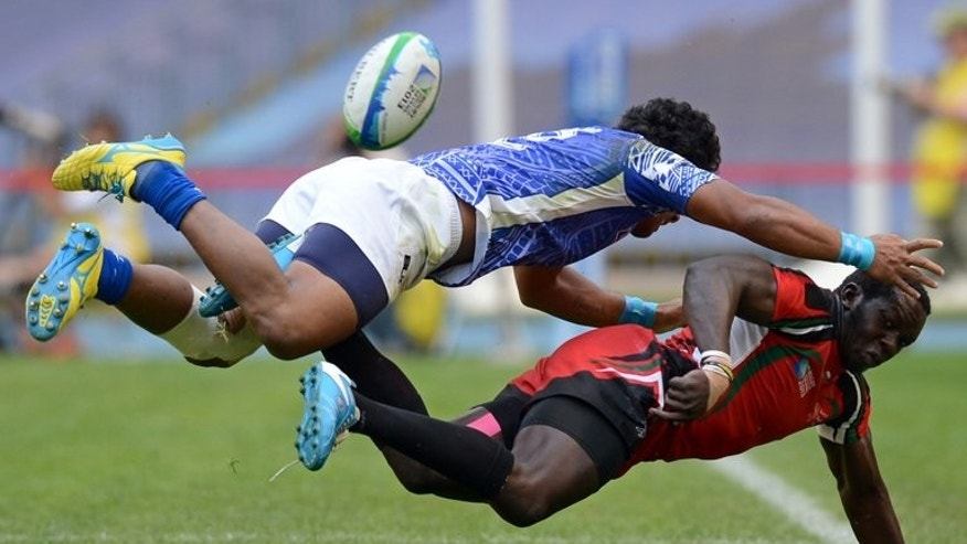 Samoa's Afa Aiono (L) takes down Kenya's Oscar Ouma at the Rugby World Cup Sevens 2013 in Moscow in June 2013.