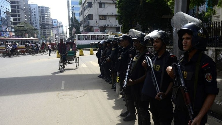 Bangladeshi police stand guard during a nationwide strike called by an Islamist party to protest the death sentenced given to its leader Abdul Quader Molla in Dhaka on September 18, 2013.