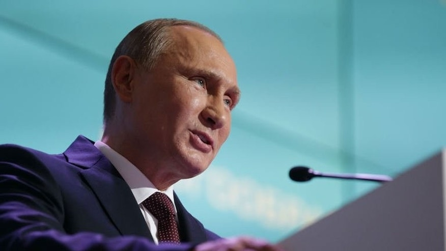 Russian President Vladimir Putin speaks during a meeting in Valdai on September 19, 2013.