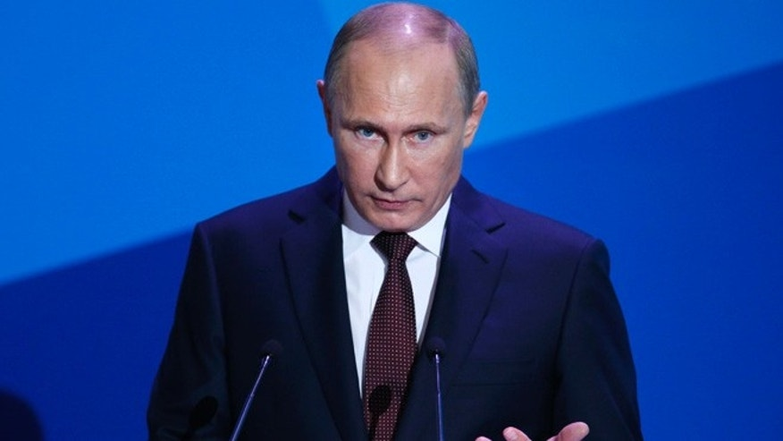Sept. 19, 2013: Russian President Vladimir Putin gestures as he speaks during the final plenary meeting of the Valdai International Discussion Club in the Novgorod Region, on the banks of Lake Valdai, Russia.