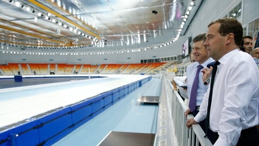 Russian Prime Minister Dmitry Medvedev (R) visits the 2014 Winter Olympic facilities in Sochi on August 7, 2013.