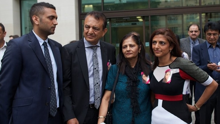 The family of murdered bride Anni Dewani leaves Westminster Crown Court in London on July 24, 2013. South African prosecutors have refused to comment on a BBC investigation which claims to have exposed holes in the murder case against the Swedish national's husband, British businessman Shrien Dewani.
