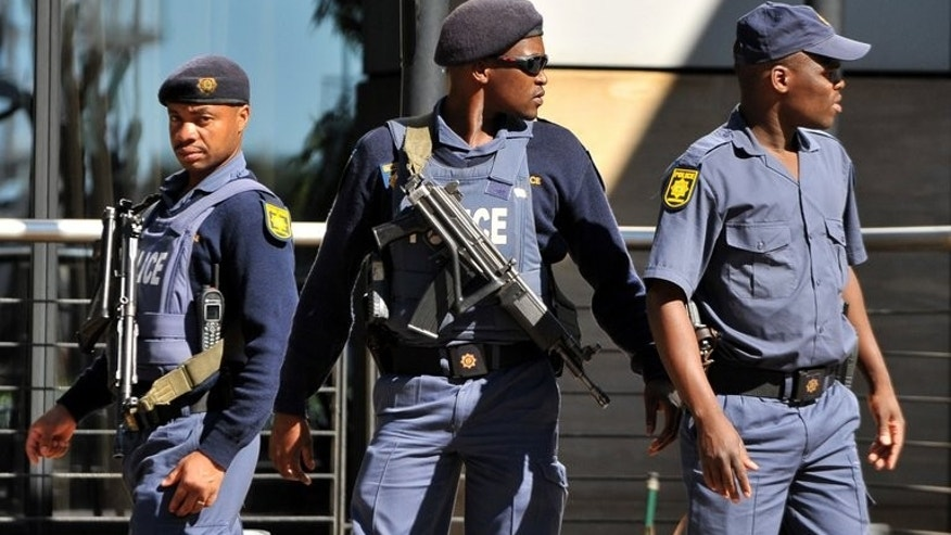 South African police patrol in Johannesburg on May 12, 2010. After years of decreasing crime, South Africa is grappling with a rise in murders, home burglaries and car hijackings, the police minister said.