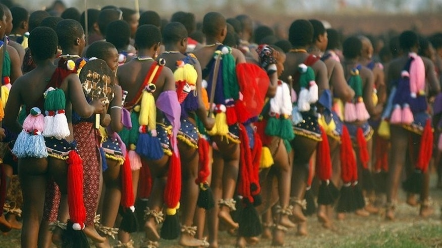 Swazi girls in traditional dress dance in front of King Mswati III in Mbabanein. The tiny mountain kingdom of Swaziland votes for a new parliament September 20, 2013.