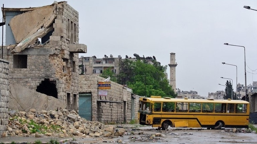 A bus is used as a barricade in Aleppo, on May 13. Roadside bombs targeting a convoy of minibuses in Syria's Homs province killed nine people on Thursday, the Syrian Observatory for Human Rights said.