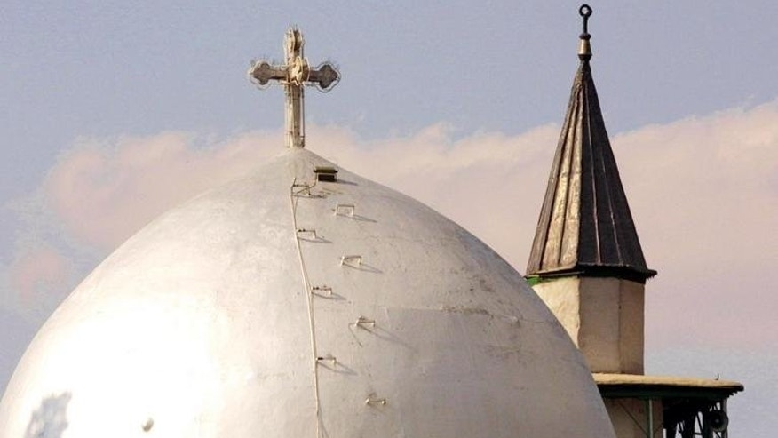 St. Serge Armenian Orthodox church (front) and the Eastern Gate Mosque in Damascus. Christian leaders from Syria and beyond are planning a summit involving Muslim representatives in a drive to use faith to spur peace efforts, the World Council of Churches said Thursday.