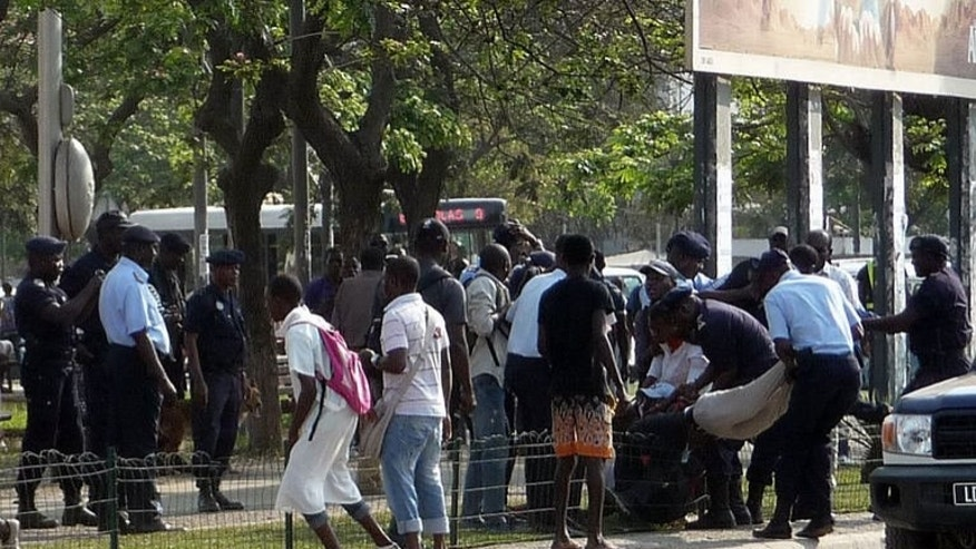 Angolan police officers arrest young protesters on September 19, 2013 at the Square of Independance in the center of Luanda while they were calling for a demonstration against social injustices.