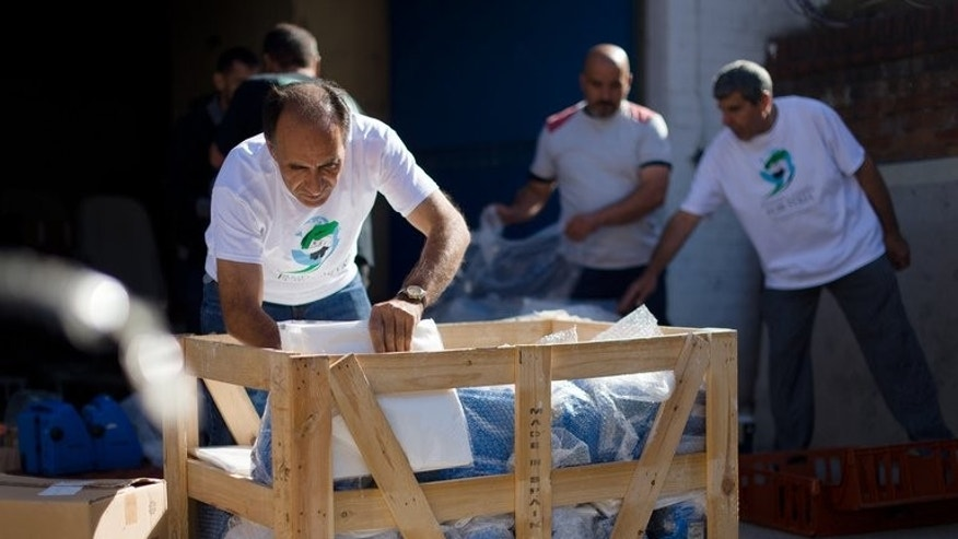 "Volunteers move medical equipment at a ""Hand in Hand for Syria"" collection point in north London on August 31, 2013. Donor countries are failing to adequately fund the humanitarian response to the Syrian crisis, the aid agency Oxfam said on Thursday."