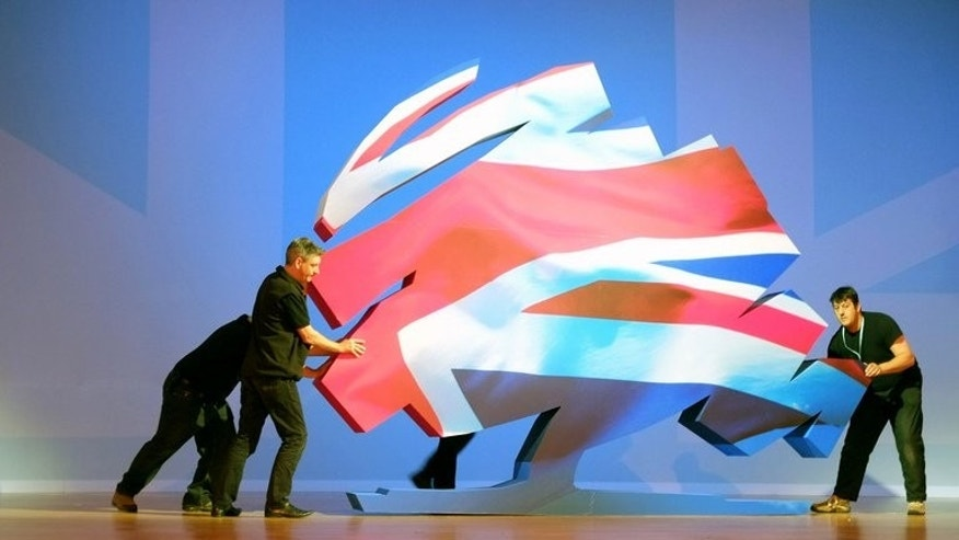 The Conservatives have drawn level with Labour, wiping out a 14 point deficit in a year, according to a survey published in Thursday's Sun. File picture shows the Conservative Party logo being set up on the final day of the 2012 Conservative Party Conference.