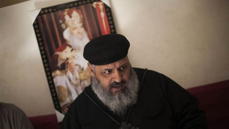 September 17, 2013: Father Abraam, the Coptic priest of Dalga, is seen during an interview with the Associated Press in Dalga, south of Cairo, Egypt. Even after the military and police stormed Dalga to wrest it from control of Islamic militants, the town's Christians fear the protection won't last and that a worse retaliation by hard-liners is still to come. (AP Photo/
