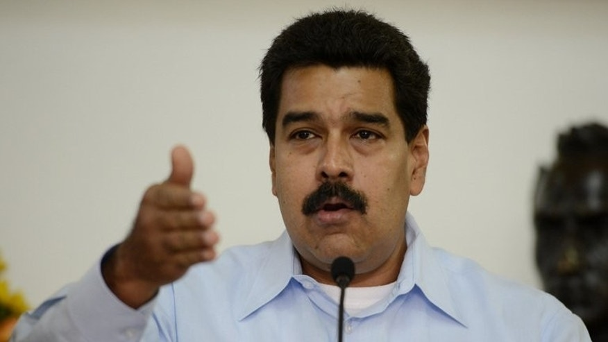 Venezuelan President Nicolas Maduro talks during a press conference at the Miraflores Presidential Palace in Caracas on September 9, 2013.