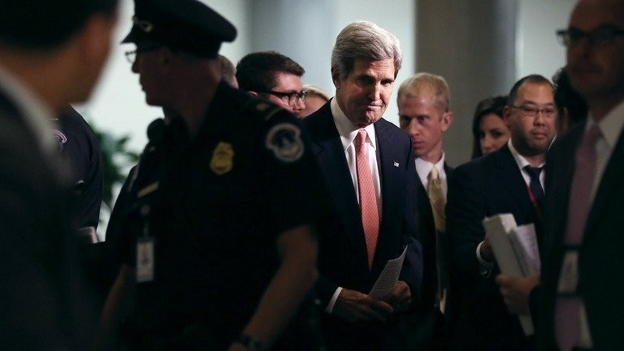 US Secretary of State John Kerry arrives for a closed briefing on Syria on September 17, 2013 in Washington, DC.