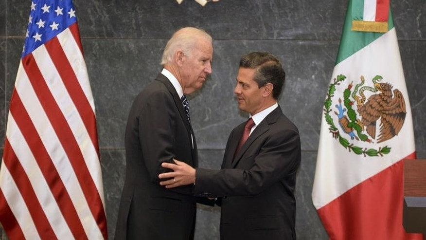 US Vice-President Joe Biden (L) and Mexican President Enrique Pena Nieto, shake hands after a press conference at the Los Pinos presidential residence in Mexico City, on September 20, 2013.