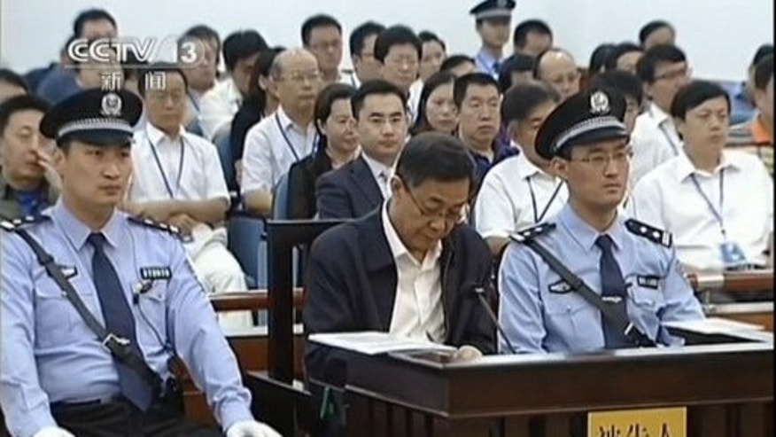 Fallen Chinese political star Bo Xilai stands trial at the Intermediate People's Court in Jinan, August 26, 2013. The verdict in the extraordinary case is due on Sunday.
