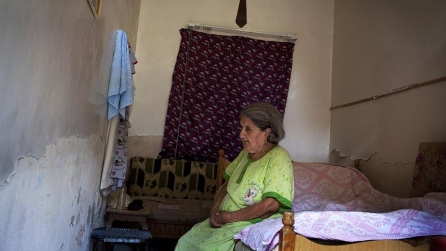 Adiba, 80, rests in her room at Mar Elias House in Aleppo on Monday. Once Syria's commercial capital, the northern city of Aleppo is said to have had a Christian community of 20-30 percent, well over double the nationwide figure.