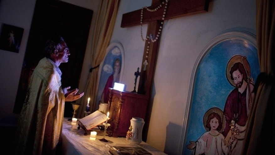Michael Oberi prays in the chapel of Mar Elias House in Aleppo, on Monday. Six Christians live in Mar Elias House, a church hostel for the indigent in the Old City that was founded in 1863, exposed daily to the sounds of fighting only metres away as government forces seek to dislodge rebels who control the area.