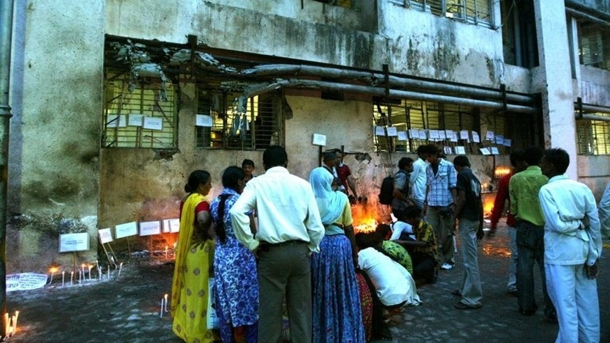 Relatives and sympathisers pay their respects with lighted candles near The Trauma Centre of The Civil Hospital in Ahmedabad on July 29, 2008, after the deaths of 56 people in a series of blasts on July 26, in the economic capital of the western Indian state of Gujarat.