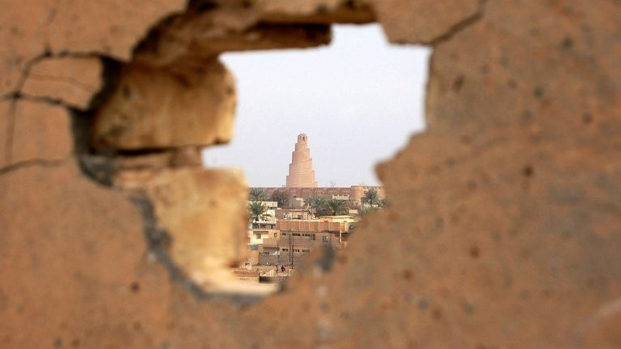 A view of the spiral minaret of Samarra's Great Mosque seen in 2008 through a wall hit by shellfire. Two bombs exploded in a Sunni mosque in Iraq as worshippers entered for prayers on Friday, killing 16 people, police and a doctor said.