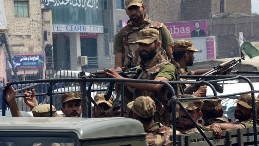 Pakistani soldiers patrol in Peshawar in August. Suspected militants on a motorbike threw grenades at a mosque in the northwestern city of Peshawar, killing at least three Islamic preachers and wounding 18 others.