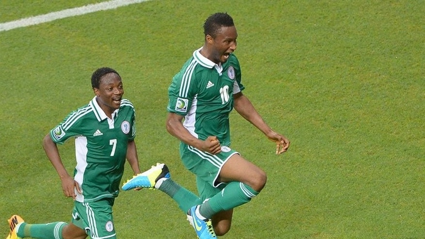 Nigeria's midfielder John Obi Mikel (R) celebrates next to teammate Ahmed Musa in Salvador, on June 20, 2013. Nigeria have named an unchanged squad from a recent qualifier at home to Malawi for next month's World Cup play-off in Ethiopia.