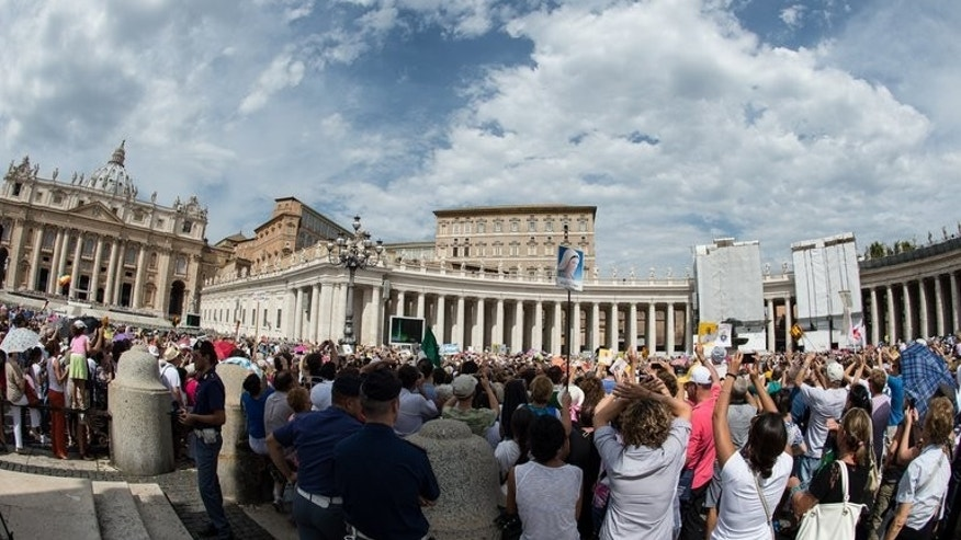 Faithfulls listen to Pope Francis's blessings from the window of his apartment during Sunday Angelus prayer in St Peter's square at the Vatican on September 8, 2013.