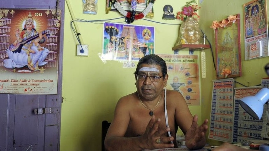Hindu priest P. K. Panchadchara tells AFP about how people travelling illegally to Australia by boat from his village of Udappuwa, pray to gods for a safe journey.