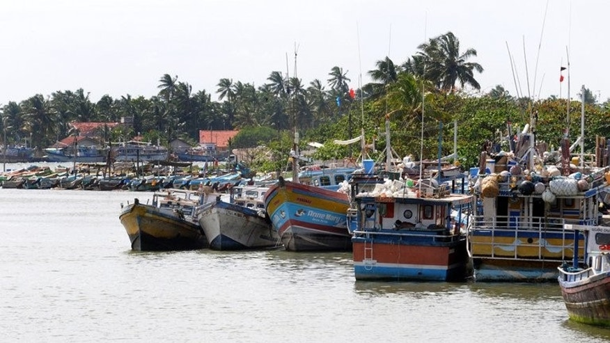 Sri Lankan boats sit anchored at the fishing harbour of Negombo. As Australia's new government launches tough measures to halt asylum seekers arriving on boats, some poor fishermen and their families half a world away in Sri Lanka seem undeterred.