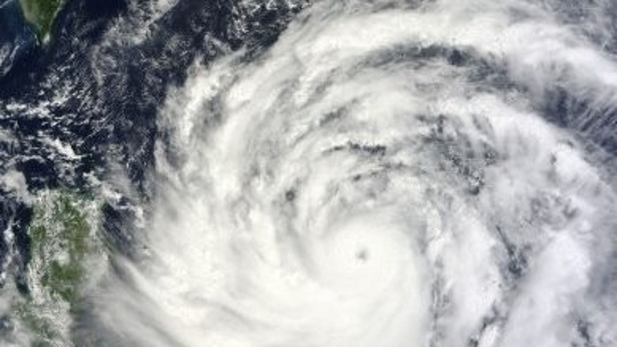 A NASA Terra satellite image obtained September 19, 2013, shows Typhoon Usagi nearing the Philippines and Taiwan.