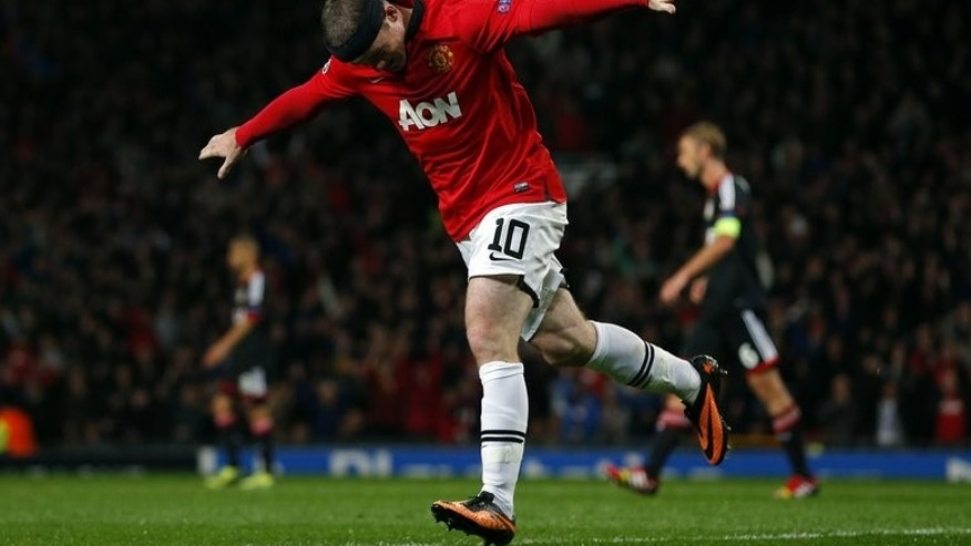 Manchester United's Wayne Rooney celebrates scoring during United's 4-2 win in a UEFA Champions League Group A match against Bayer Leverkusen at Old Trafford on September 17, 2013.