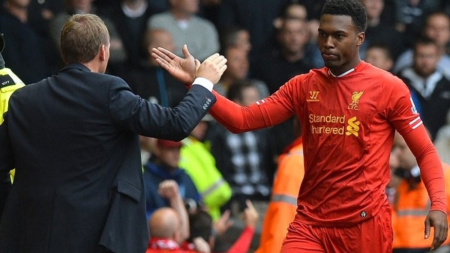 Liverpool's Daniel Sturridge (R) celebrates with manager Brendan Rodgers after scoring the opening goal in an English Premier League match against Manchester United at Anfield on September 1, 2013.
