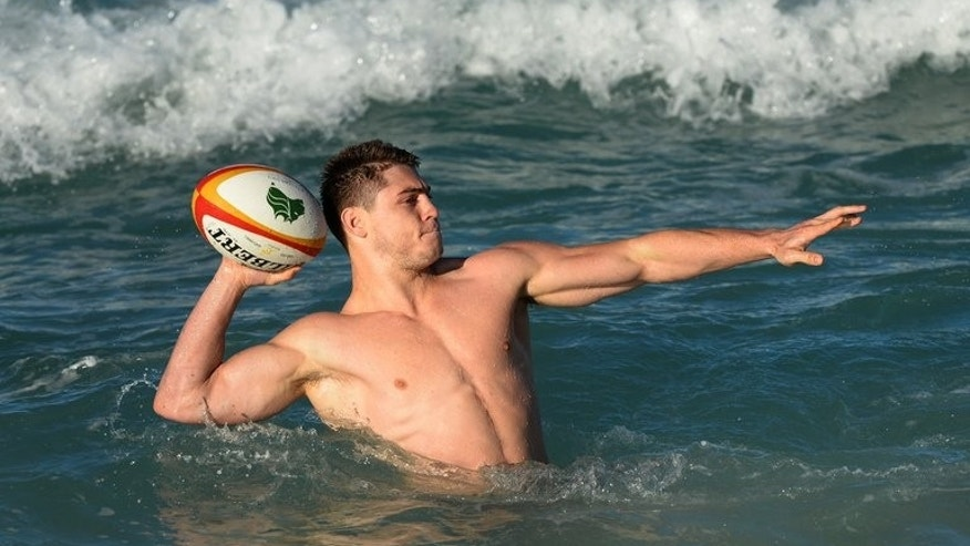 James O'Connor relaxes in the surf during a recovery session on Sydney's Coogee Beach on July 1, 2013. O'Connor, who vowed just a month ago to change his ways in a bid to keep his Wallaby jersey, ended up in trouble trying to board a plane to Bali with his girlfriend hours after Australia beat Argentina in the Rugby Championship on Saturday.