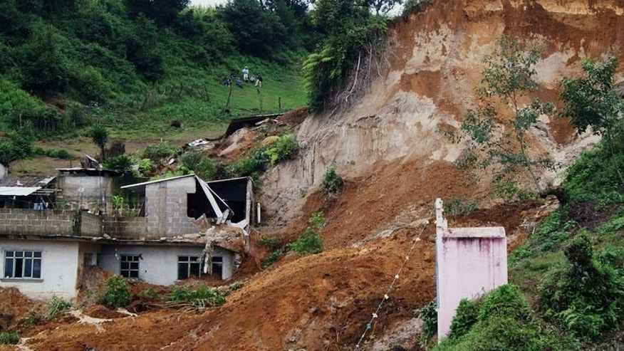 Picture of a landslide in Altotonga, State of Veracruz, Mexico, on September 16, 2013. Thousands of people were evacuated on both sides of the country as two storms set off landslides and floods that damaged bridges, roads and homes.