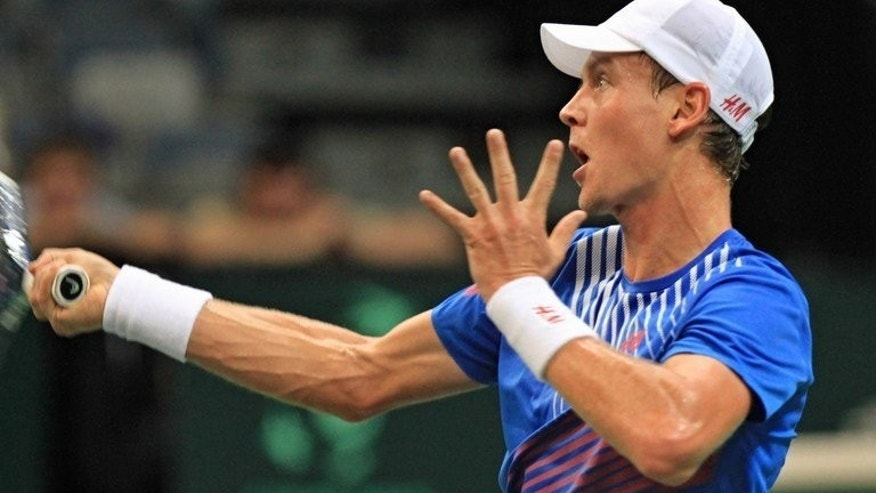 Czech Tomas Berdych reacts during a match against Argentina's Leonardo Mayer on September 13, 2013, in Prague.