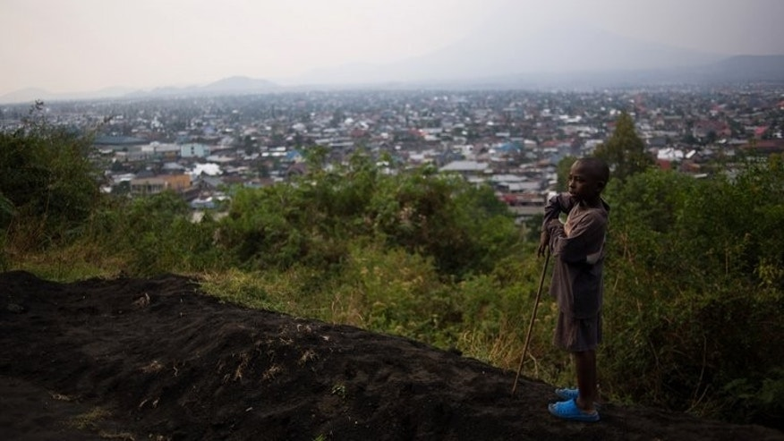 A young boy stands atop Mount Goma overlooking the capital of North Kivu province in the east of the Democratic Republic of the Congo on August 1, 2013.