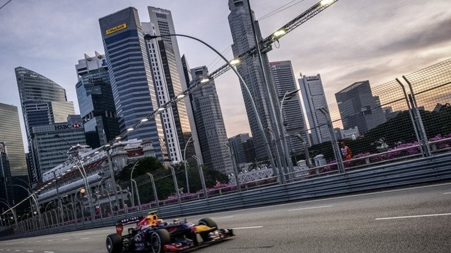 Red Bull driver Mark Webber of Australia drives during a practice session in Singapore on September 21, 2013.