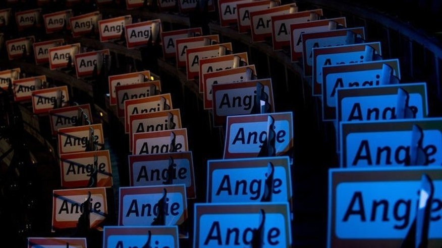 "Posters with German Chancellor Angela Merkel's nickname ""Angie"" on display at an election rally in Berlin, on September 21, 2013. Merkel is given a rousing chorus of ""Angie must save the world"" at a last-ditch campaign push for votes as a survey released on the eve of German elections suggested a photo finish."
