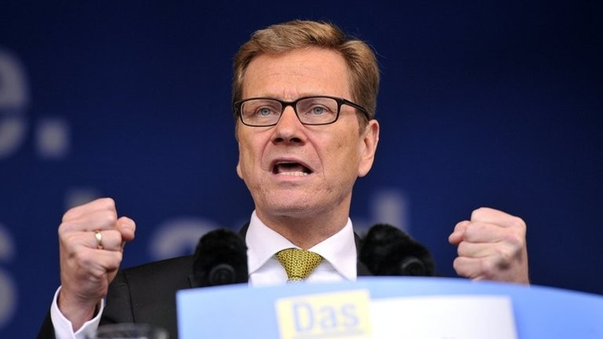 German Foreign Minister Guido Westerwelle of Germany's free democratic party gives a speech on September 21, 2013.