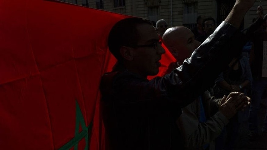 Dozens of people protest in front of Morocco ambassy, on September 21, 2013 in Paris, to call for the release of Ali Anouzla, a news website editor arrested on September 17 in Rabat after he posted an article about a jihadist video.