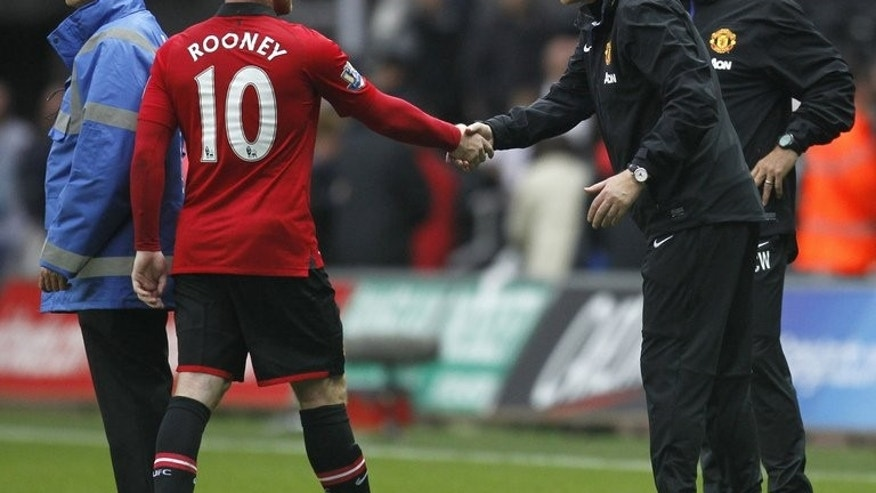 "Manchester United's manager David Moyes (right) shakes hands with striker Wayne Rooney at Liberty Stadium in Swansea, south Wales, on August 17, 2013. Moyes has revealed that he thought star striker Rooney had ""gone soft"" when he first arrived at the club."