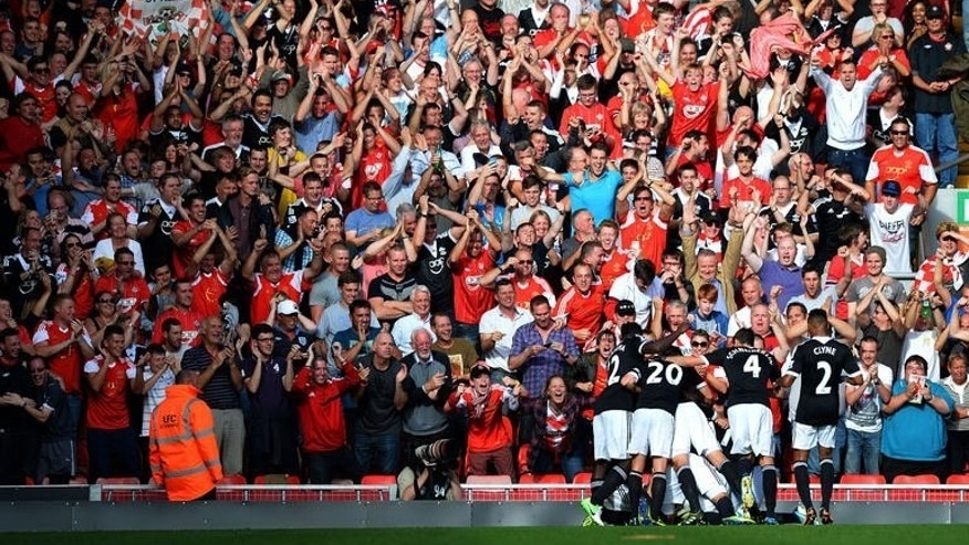 Southampton players celebrate scoring during their English Premier League football match against Liverpool at Anfield stadium in Liverpool, northwest England, on September 21, 2013. Southampton won 1-0.