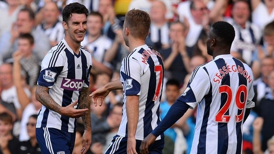 West Bromwich Albion's defender Liam Ridgewell (L) celebrates after scoring against Sunderland at The Hawthorns in West Bromwich, central England, on September 21, 2013.