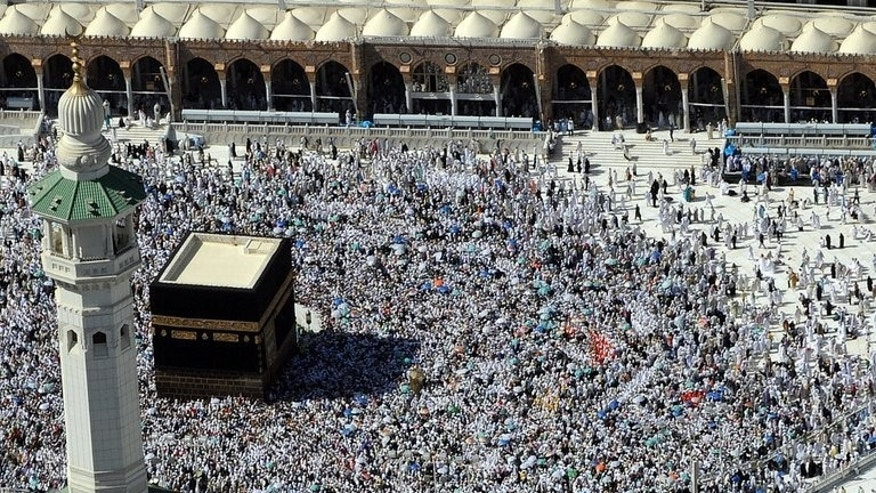 Muslim pilgrims walk around the Kaaba at the Grand Mosque during the annual Hajj pilgrimage in Mecca, on November 7, 2011.