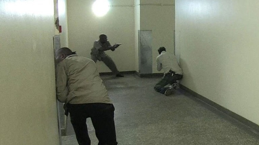 An image grab taken from AFP TV shows Kenyan security forces taking position inside a shopping mall following an attack by masked gunmen in Nairobi on September 21, 2013.